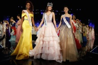 Winner of Miss World Miss Puerto Rico Stephanie Del Valle (C) stands with first runner up Miss Dominican Republic Yaritza Miguelina Reyes Ramirez (L) and second runner up Miss Indonesia Natasha Mannuela during the Miss World 2016 Competition in Oxen Hill, Maryland, U.S., December 18, 2016. REUTERS/Joshua Roberts