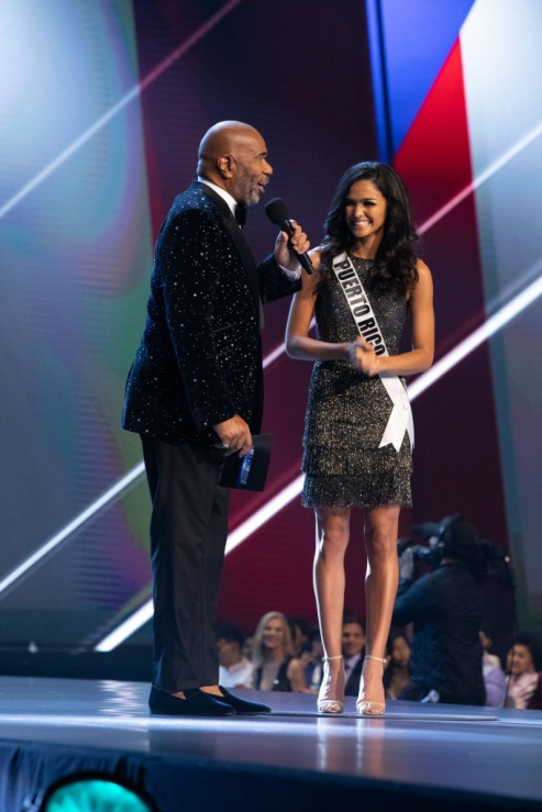 Kiara Ortega, Miss Puerto Rico 2018 on stage in fashion by Sherri Hill with host Steve Harvey as a Top 20 finalist during The MISS UNIVERSE® Competition airing on FOX at 7:00 PM ET live/PT tape-delayed on Sunday, December 16, 2018 from the IMPACT Arena in Bangkok, Thailand. Contestants from around the globe have spent the last few weeks touring, filming, rehearsing and preparing to compete for the Miss Universe crown. HO/The Miss Universe Organization